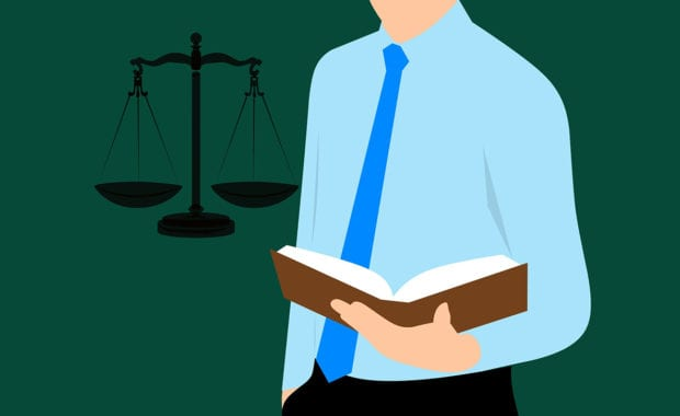 lawyer using a reference tools for ways to boost client engagement